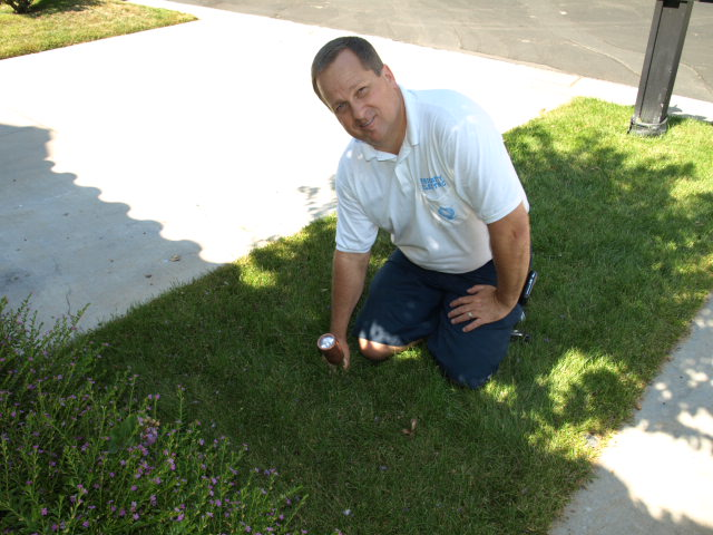 priority electric electrical contractor installing spot fixtue